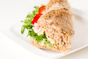 Prawn sandwich on white plate close up