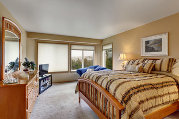 Large bedroom with stripped bedding.