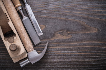 Composition of claw hammer wooden shaving plane and flat chisels