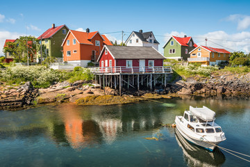 Wall Mural - Fishing village Henningsvaer in Lofoten islands, Norway with typical colorful wooden buildings