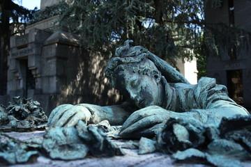 Italy, Milan. Gravestone at Cimitero Monumentale, an infinite sadness