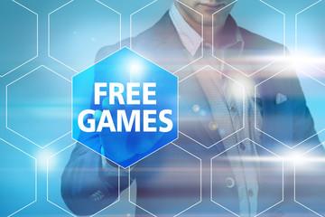 Businessman pressing free games button on virtual screens. Busin