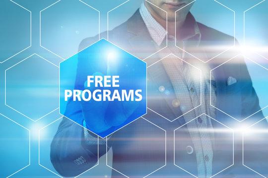 Businessman pressing free programs button on virtual screens. Bu
