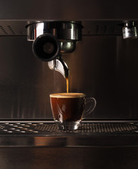 Hot coffee flow to a cup on espresso machine