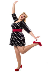 Excited woman posing in one leg