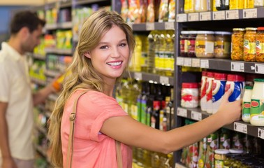 Portrait of a pretty blonde woman buying food products