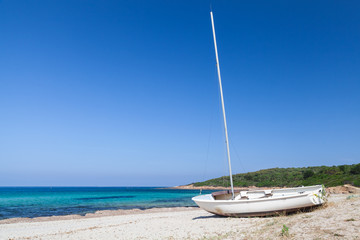 Sailing boat on beach, Corsica island, France