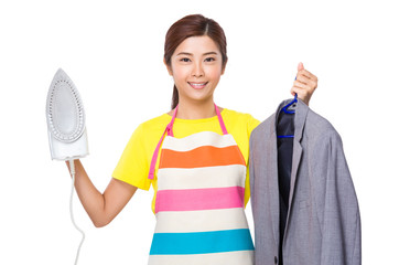 Housewife holding with suit jacket and ironing