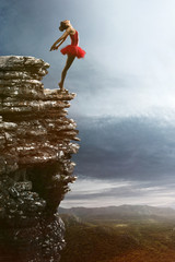 Ballet Dancer balances on a rock