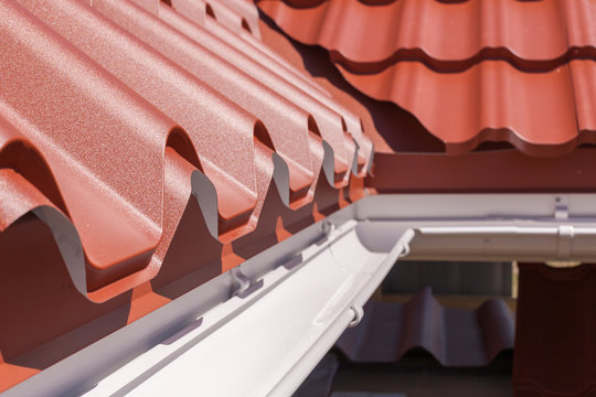 New red metal tile with white rain gutter