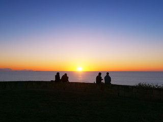 people watching the sunset in Sopelana