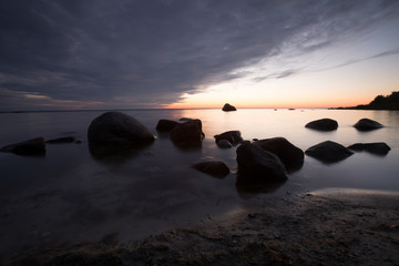 Sunset over the baltic sea, rocks in the water