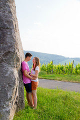 Young love couple in a vineyard