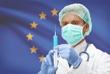 Doctor with syringe in hands and flag on background series - European Union - EU