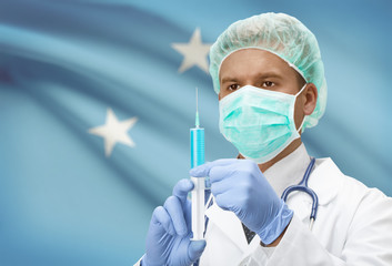 Doctor with syringe in hands and flag on background series - Micronesia