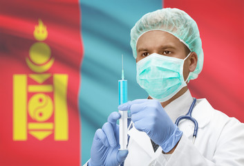 Doctor with syringe in hands and flag on background series - Mongolia