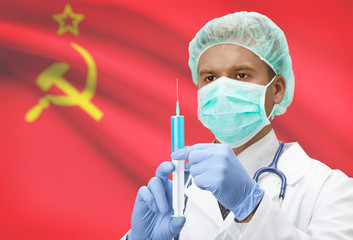 Doctor with syringe in hands and flag on background series - USSR - Soviet Union