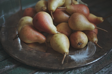 Pears on metal tray on a rustic background