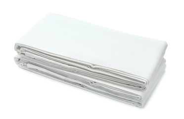Stack of white folded bedding