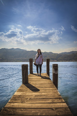 Woman standing on a wooden pier