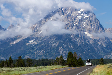 Car on the main road through Grand Teton National Park in Wyoming