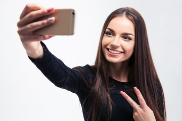 Woman in black dress making selfie photo