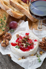 delicious appetizers for wine - camembert, berry jam, toast