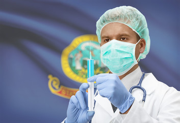 Doctor with syringe in hands and US states flags on background series - Idaho