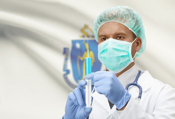 Doctor with syringe in hands and US states flags on background series - Massachusetts