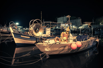 Small wooden fishing boats moored in Ajaccio