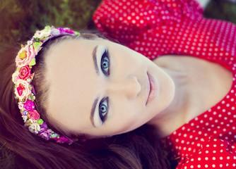 Portrait of the summer woman in a flower headband