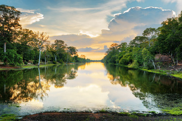 Sunset over ancient moat surrounding Angkor Thom, Cambodia