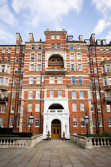 Albert Court, London. The facade of an upmarket apartment block in Kensington, West London.