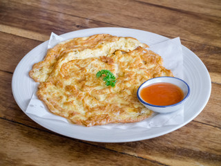 Omelette with chilli sauce