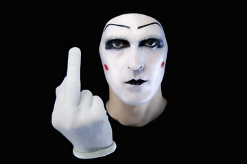 Portrait of the mime in white gloves. fuck you