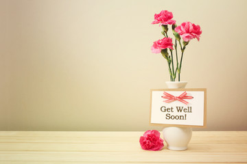 Get well soon message with pink carnations