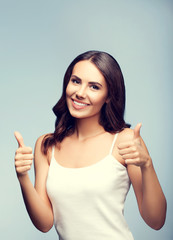 Portrait of happy woman showing thumb up gesture