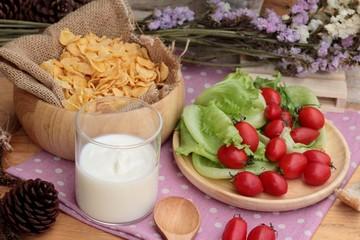 White yogurt and fresh cherry tomatoes with cornflake.