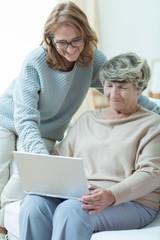 Carer teaching old woman
