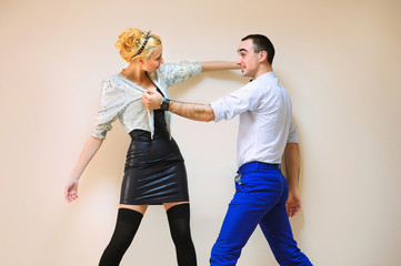 Fashion and funny  friends simulating fighting each other on