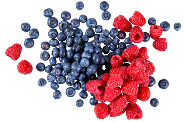 Fresh Organic  Blueberries and Raspberries.  Rich with vitamins. Isolated on white background