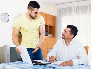 two men with documents