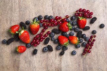 Some gooseberries, raspberries, strawberries and blueberries ove