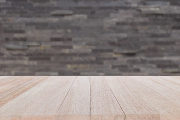 Empty top wood table and stone wall background