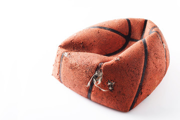Old damaged rubber basket ball on background