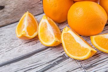 Orange fruits over weathered wooden background