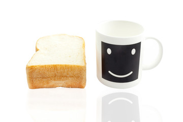 Empty smile coffee cup or smile coffee mug and sliced bread isol