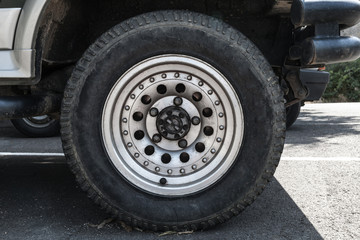 Off-road car wheel on steel disc, closeup photo