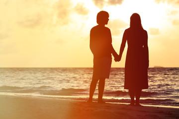 Romantic couple on the beach at sunset