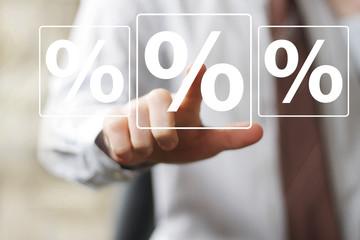 Businessman push virtual button percent sign